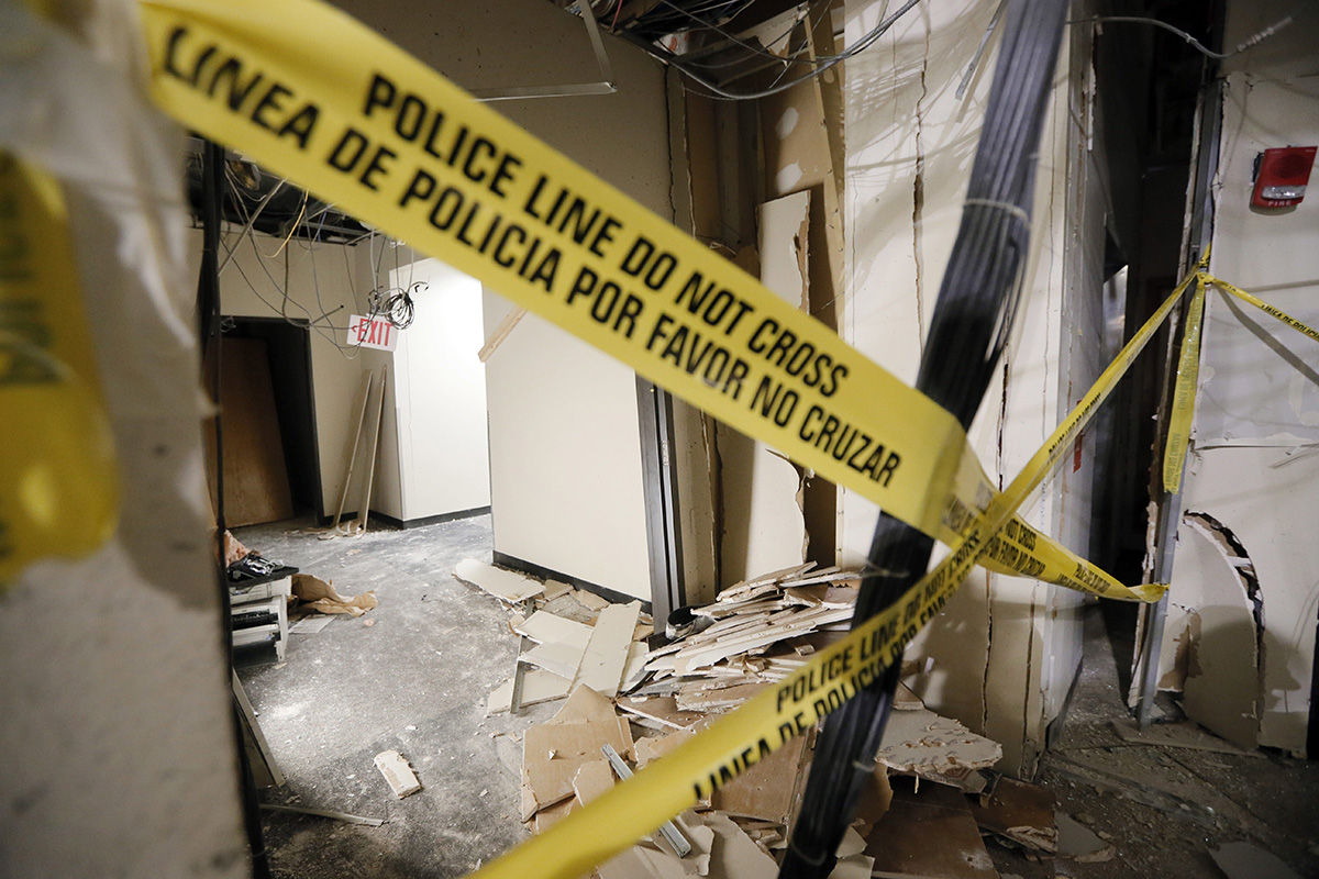Damage from a blast is shown in a hallway at El Centro College downtown campus, Tuesday, July 19, 2016, in Dallas.