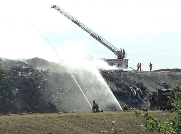 Fire officials spent Sunday battling a blaze at a Liverpool area landfill.  Sunday, July 24, 2016.