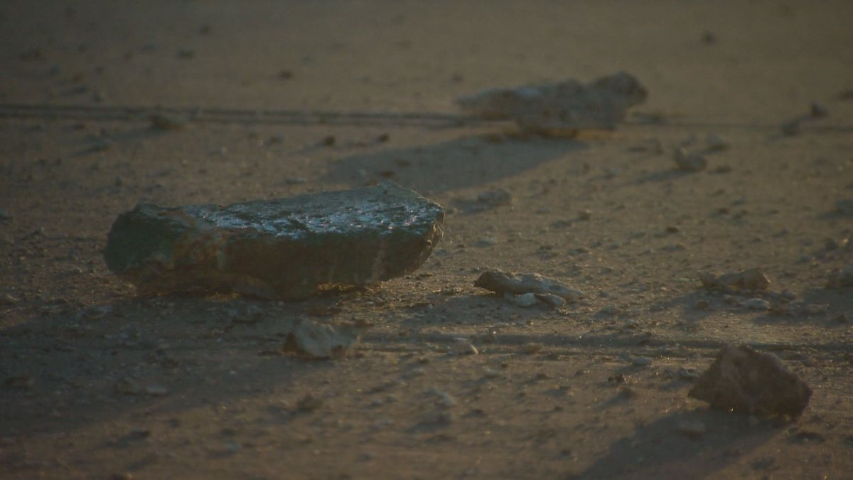 Chunks of concrete fell from a Highway 102 overpass onto an Ashburn Avenue sidewalk in Halifax on July 7, 2016.