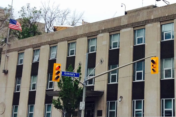 A woman has been charged after police say a guard at the U.S. consulate in Toronto was attacked.