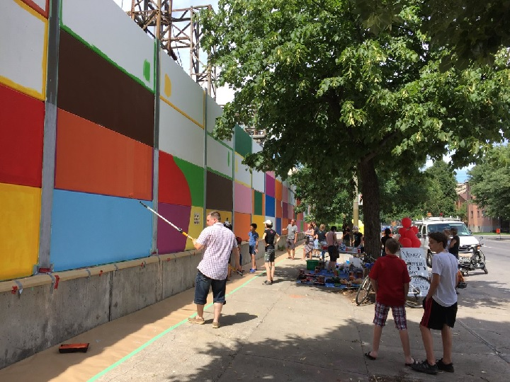 Little Burgunday residents take part in large-scale mural aimed at revitalizing the neighbourhood. Sunday, July 24, 2016.