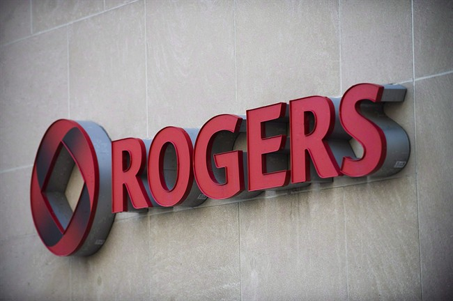The Rogers Communications sign is shown at the company's headquarters in Toronto, April 25, 2012. A legal battle is brewing over the use of TV boxes that grant access to web streaming content in a standoff that raises questions about the need to protect copyright while fostering innovation. THE CANADIAN PRESS/Aaron Vincent Elkaim.