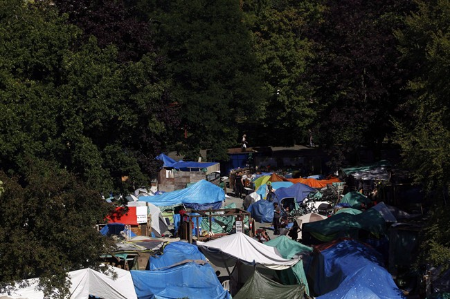 Residents at Tent City, also known as Super InTent City, are seen in Victoria, B.C., Tuesday, June 28, 2016 .