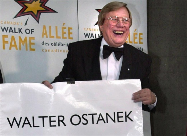 """Walter Ostanek unveils his star at his induction into the Walk of Fame along King Street in Toronto on June 1, 2001. Canada's reigning """"Polka King"""" is adding a lottery win to his list of accolades. Walter Ostanek has had a successful 60-year career, with three Grammy wins and the Order of Canada under his belt. Now he's also claiming the $1 million grand prize in the London, Ont. Dream Lottery. THE CANADIAN PRESS/J.P.Moczulski."""