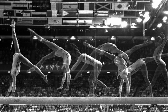 A multiple-exposure photo show Romania's Nadia Comaneci, 14, performing her part of the balance beam routine in the Montreal Summer Olympic Games in a July 23, 1976, file photo. All the world seemed to fall in love with the ponytailed 14-year-old from Romania who became the first to earn a perfect 10 score on the uneven bars.