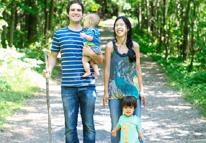 Simon Laporte with his wife, Pascale Vo, and their two children, Olivier and Simon. The couple created Oli & Bou, a company that designs clothes for children with dwarfism after Olivier was diagnosed.