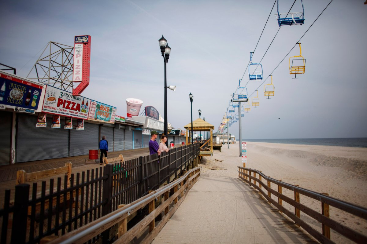People stand on the Seaside Heights boardwalk  two years after Hurricane Sandy on October 29, 2014. Hurricane Sandy was recorded as the deadliest and most destructive hurricane of the 2012 Atlantic hurricane season.