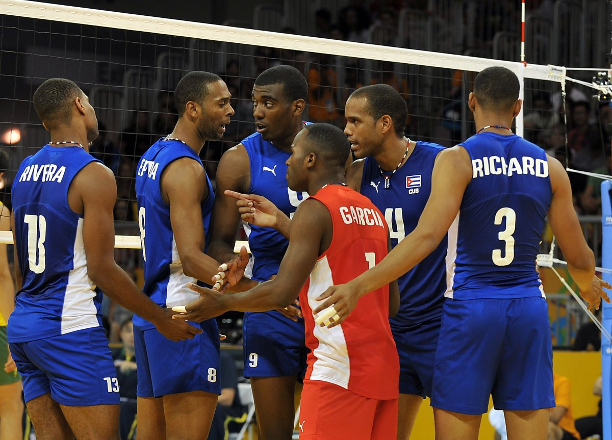 The Cuban team confers during the Men's Volleyball match Brazil vs. Cuba at the 2015 Pan American Games in Toronto, Canada July 19, 2015.