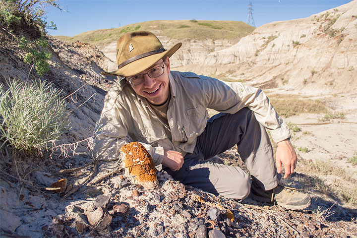 Scott Persons poses with Hannah's horn after spotting it in the Badlands.