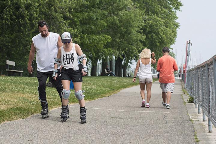 People enjoy the hot weather at Coronation Park, near Lake Shore Boulevard, in Toronto, Monday, June 20, 2016.