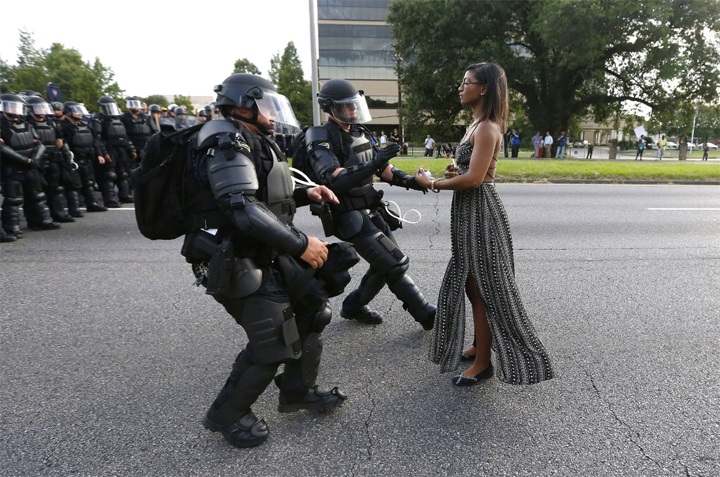 The now-famous picture was taken Saturday outside of the Baton Rouge Police headquarters where demonstrators had formed a blockade.
