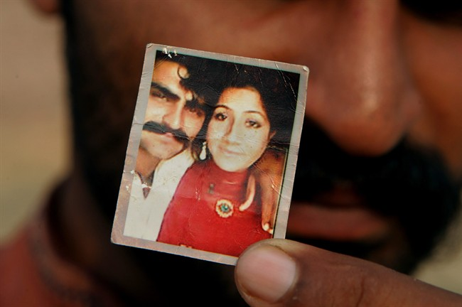 Mohammed Tofeeq shows a picture with his wife Muqadas Tofeeq, who local police say was killed by her mother, in Butrawala village on the outskirts of Gujranwala, Pakistan.