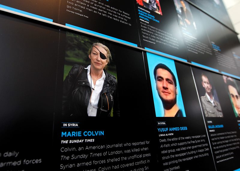 In this May 13, 2013, file photo, the photo of Journalist Marie Colvin who was killed in Syria while she was reporting from there, is seen on the wall of the Newseum during the Journalist Memorial Re-dedication ceremony of the journalists who died reporting the news in 2012 in Washington.