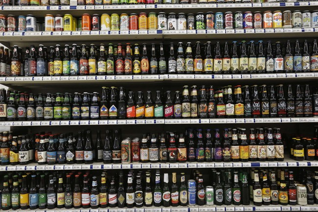 File: A shelf is stocked high with hundreds of varieties of single beers.