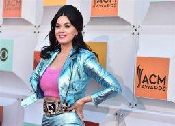 Continue reading: Katy Perry, Ellen DeGeneres surprise Orlando shooting survivor in tear-jerking moment