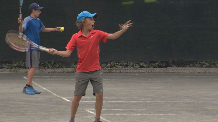 Kids playing tennis at the Monkland Tennis Club, July 8, 2016.