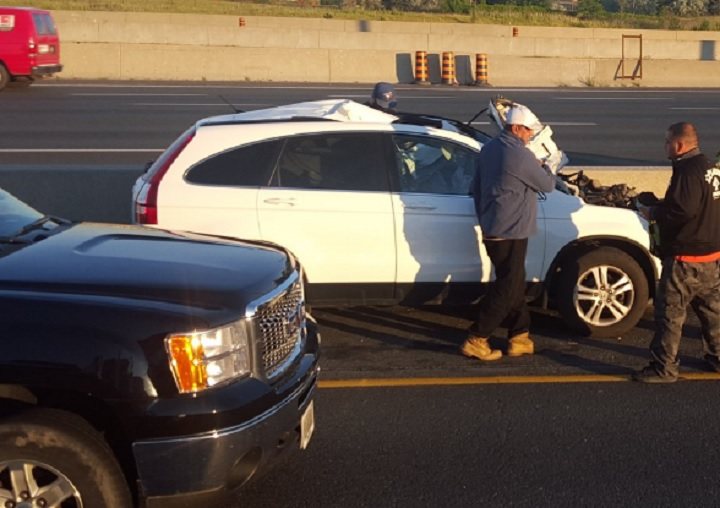 A white Honda SUV was apparently struck by a tire on Highway 401 in Toronto on July 4, 2016.