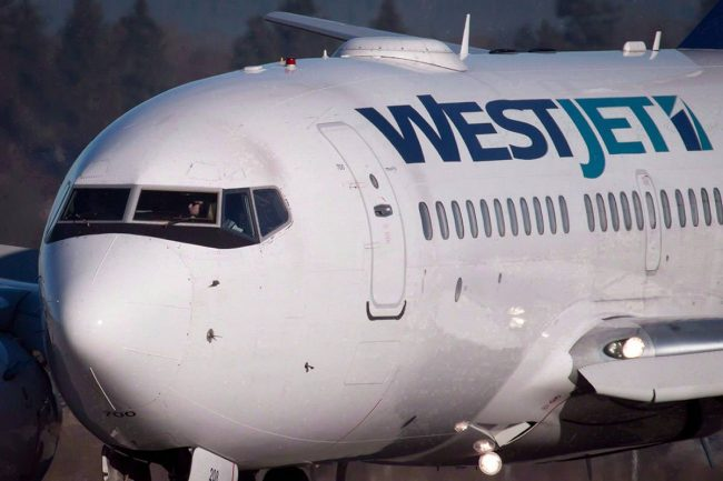 A pilot taxis a Westjet Boeing 737-700 plane to a gate after arriving at Vancouver International Airport in Richmond, B.C., on Monday, February 3, 2014.