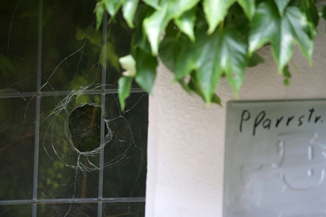 A broken window photographed at the site of the attack in Ansbach, Germany, Tuesday July 26, 2016. In the most recent attack in Germany, a 27-year-old Syrian asylum-seeker set off a backpack laden with explosives and shrapnel Sunday night after being refused entry to a crowded music festival in the Bavarian city of Ansbach, killing himself and wounding 15 people. (Daniel Karmann/dpa via AP).