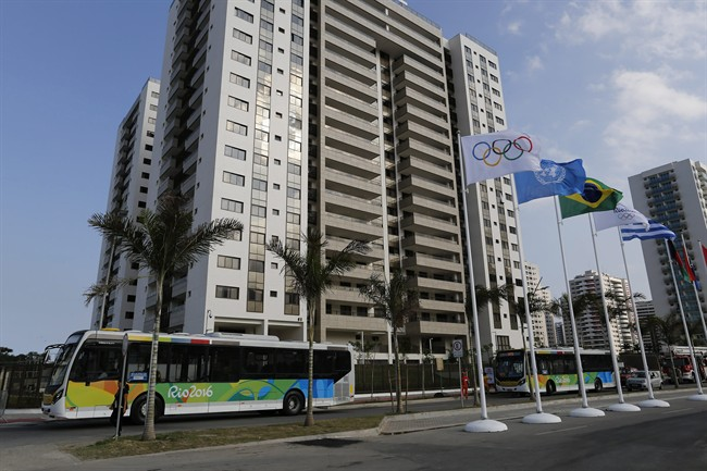 The Olympic Village stands in Rio de Janeiro, Brazil, Saturday, July 23, 2016. The brand new complex of residential towers are where nearly 11,000 athletes and some 6,000 coaches and other handlers will sleep, eat and train during the upcoming games, that will kickoff on Aug. 5.