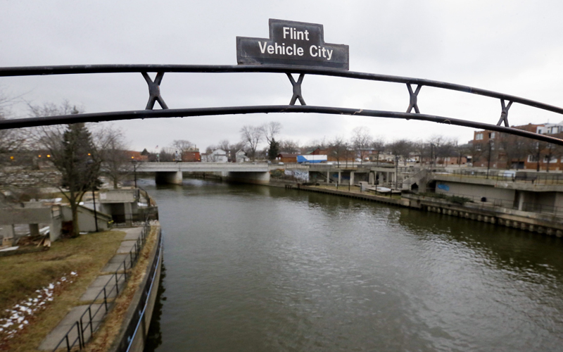 A sign over the Flint River in Flint, Mich.