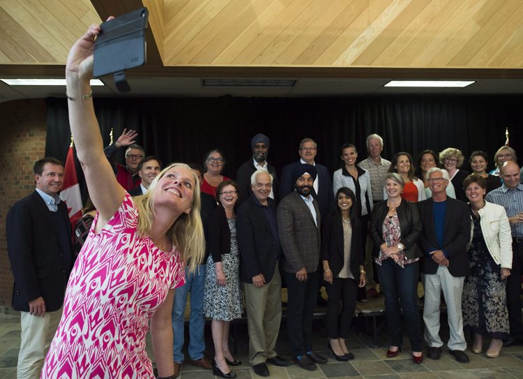 Environment Minister Catherine McKenna, left, takes a selfie at a Liberal cabinet retreat in 2016. Justin Trudeau's cabinet has an equal number of men and women.