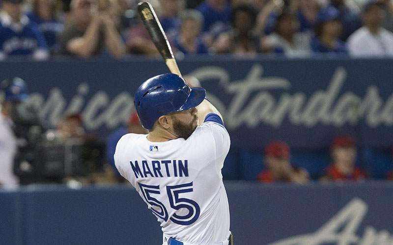 Toronto Blue Jays' Russell Martin hits a three run double against the Minnesota Twins during sixth inning Major League baseball action in Toronto on Friday August 26, 2016.
