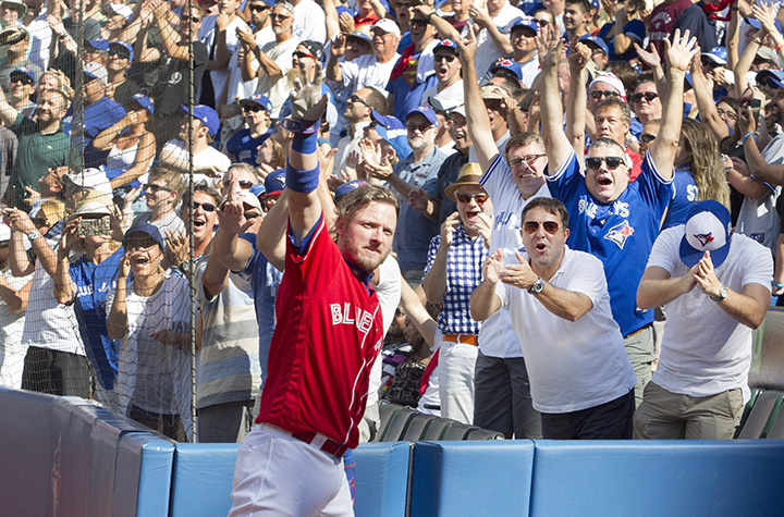Toronto Blue Jays' Josh Donaldson takes a curtain call after his third home run in their American League MLB baseball game against the Minnesota Twins in Toronto on Sunday.