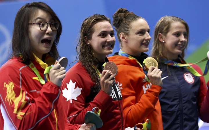 Fu Yuanhui of China, Kylie Masse of Canada, Katinka Hosszu of Hungary and Kathleen Baker of USA pose with their medals after the women's 100m backstroke final.