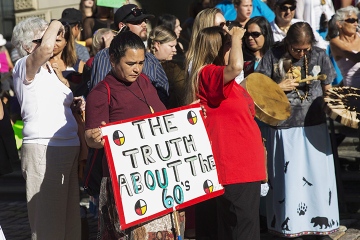 '60s Scoop survivors and supporters gather for a demonstration at a Toronto courthouse on Tuesday, August 23, 2016. Scores of aboriginals from across Ontario rallied in Toronto today ahead of a landmark court hearing on the so-called '60s Scoop.