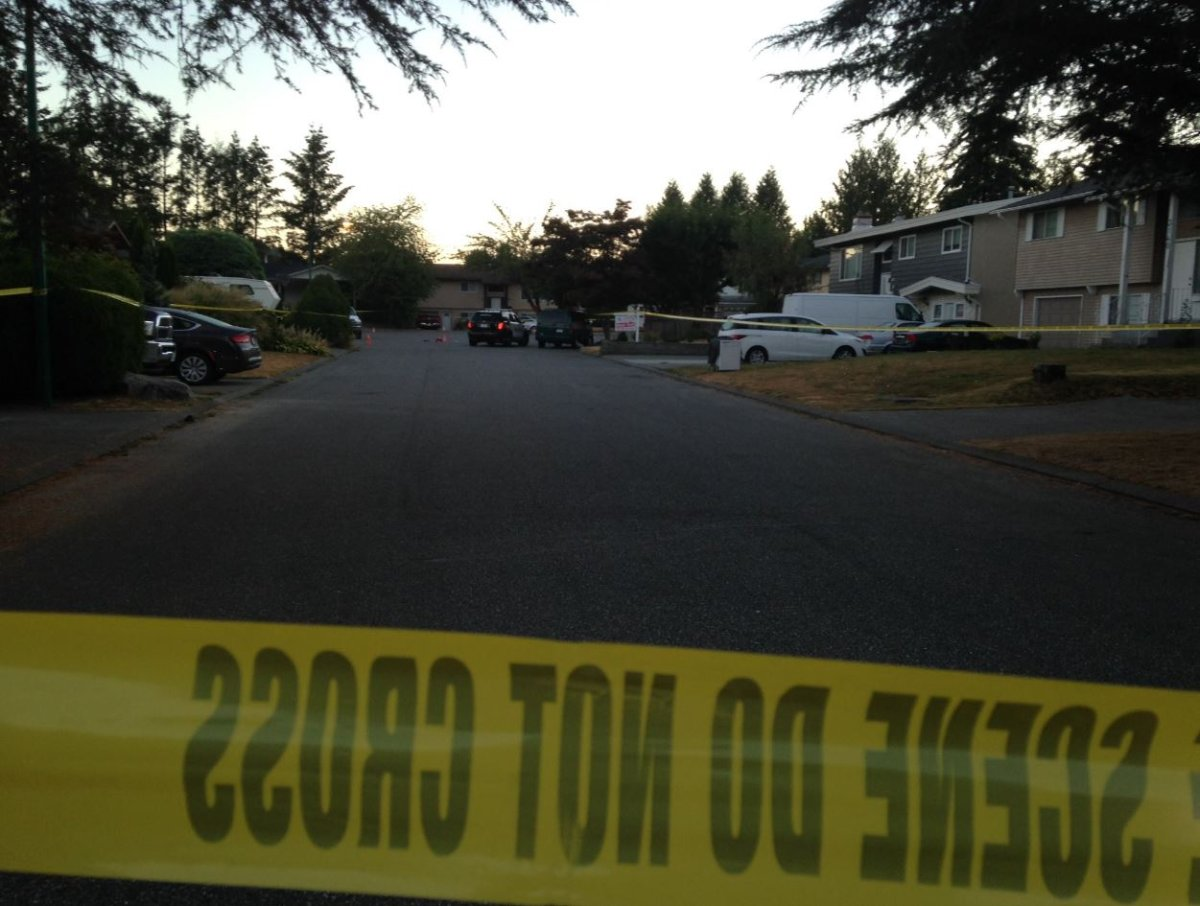 Investigators on scene following a shooting in Abbotsford on Aug. 17.