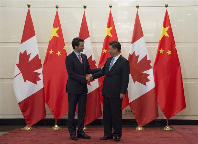 Chinese President Xi Jinping welcomes Canadian Prime Minister Justin Trudeau to the Diaoyutai State Guesthouse in Beijing, Wednesday August 31, 2016. China has rejected Canada's efforts to inject labour standards into a free trade agreement.
