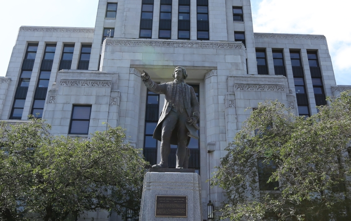 Statue of Captain George Vancouver outside Vancouver City Hall.
