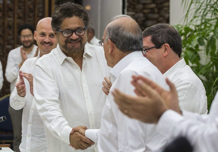 Humberto de La Calle, right, head of Colombia's government peace negotiation team shakes hands with Ivan Marquez, chief negotiator of the Revolutionary Armed Forces of Colombia after signing a peace agreement in Havana, Cuba, Wednesday, August 24, 2016. Colombia's government and the country's biggest rebel group reached a deal for ending a half-century of hostilities in what has been one of the world's longest-running armed conflicts.