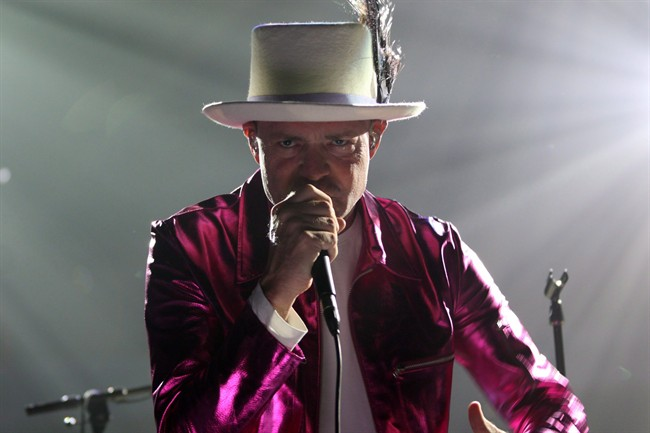 The Tragically Hip's Gord Downie, performs during the first stop of the Man Machine Poem Tour at the Save-On-Foods Memorial Centre in Victoria, B.C., Friday, July 22, 2016.