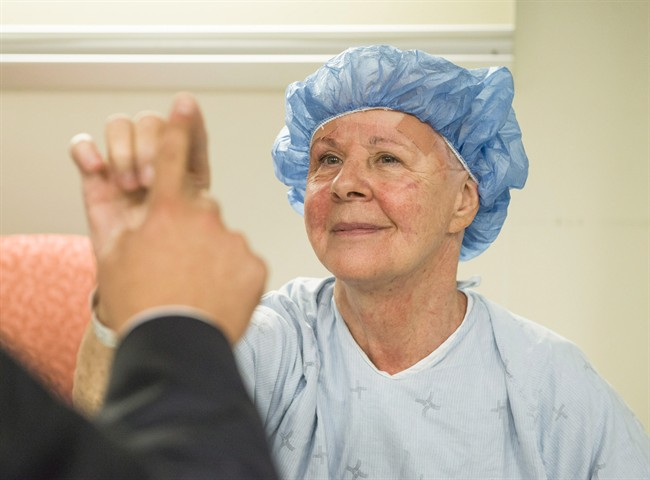 Noreen Smith of Bobcaygeon, Ont. tests out the steadiness of her hand with a neurosurgeon after undergoing an MRI-guided focused ultrasound for essential tremor, a common neurological condition that causes uncontrollable shaking, in a handout photo.