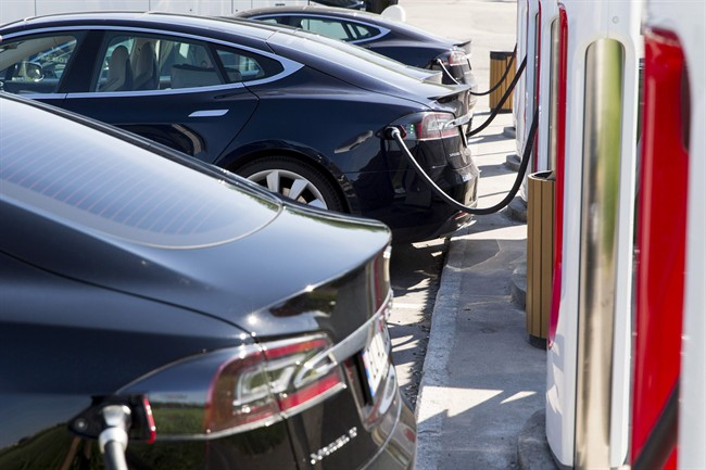Tesla cars charge at a station in Norway.