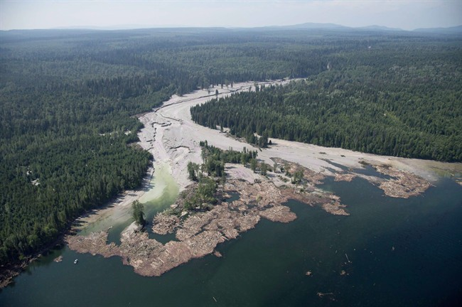 Contents from a tailings pond is pictured going down the Hazeltine Creek into Quesnel Lake near the town of Likely, B.C. on August, 5, 2014. It's been two years since millions of cubic metres of mine waste gushed from a tailings pond at the Mount Polley mine in British Columbia's Interior. The government says it has implemented tough new regulatory standards, while environmental groups say more protections are needed and residents just want their pristine lake back.