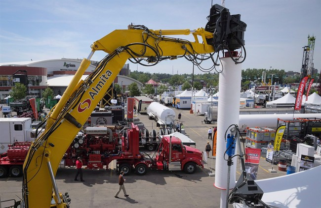 FILE - Heavy machinery is on display at the Global Petroleum Show in Calgary in a June 7, 2016, file photo. Five years after Alberta raised a record-setting $3.5 billion at auctions of provincially owned oil and gas drilling rights, sales are on pace this year to set a historic low, part of a downward trend seen across Western Canada.