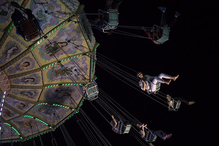 Visitors take the swing ride at the Canadian National Exhibition in Toronto on Saturday, August 23, 2014.