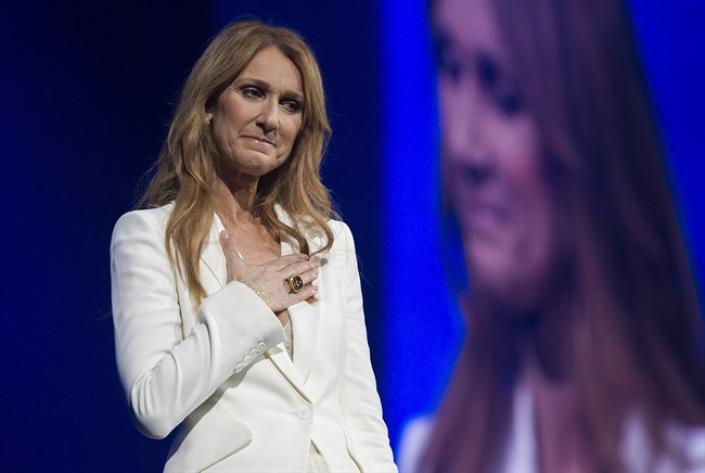 Celine Dion gestures as she performs in concert at the Bell Centre in Montreal, Sunday, July 31, 2016.