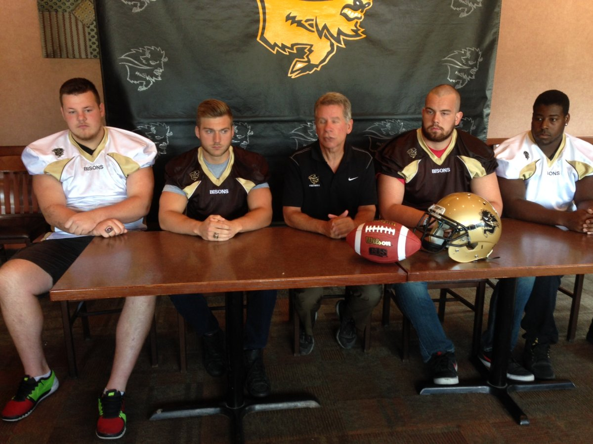 Bison recruit Derek Yachison (second from left) along with head coach Brian Dobie (middle) and three fellow additions  to the roster .