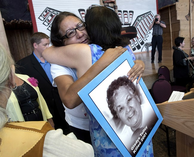 Bridget Tolley, whose mother Gladys was killed in 2001, is embraced after the announcement of the inquiry into Murdered and Missing Indigenous Women at the Museum of History in Gatineau, Quebec on Wednesday, Aug. 3, 2016.