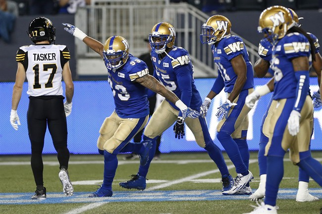 Winnipeg Blue Bombers' Justin Cole (93) celebrates his sack on Hamilton Tiger-Cats' quarterback Jeremiah Masoli (8) during the first half of CFL action in Winnipeg Wednesday, August 3, 2016.