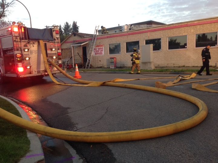 Fire crews battle a blaze at a vacant laundromat in the area of 149 Street and 97 Avenue Saturday, August 13, 2016.