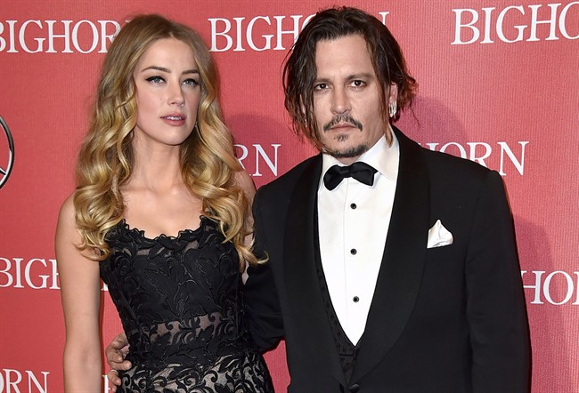 Amber Heard, left, and Johnny Depp arrive at the 27th annual Palm Springs International Film Festival Awards Gala in Palm Springs, Calif.