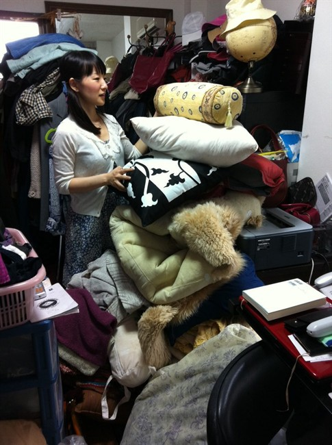 """Marie Kondo working at a client's home to clear away everything that is unneeded in Tokyo, Japan. Kondo is the author of the book, """"The Life-Changing Magic of Tidying Up.""""."""