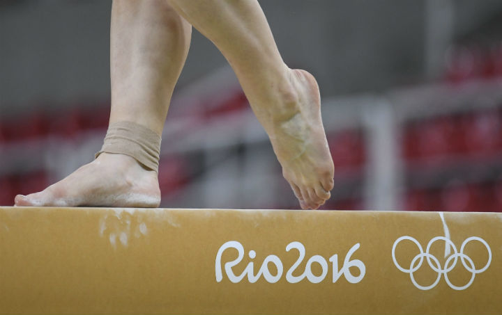An athlete on the balance beam during a training session for the Rio 2016 Olympic Games events at the Rio Olympic Arena.