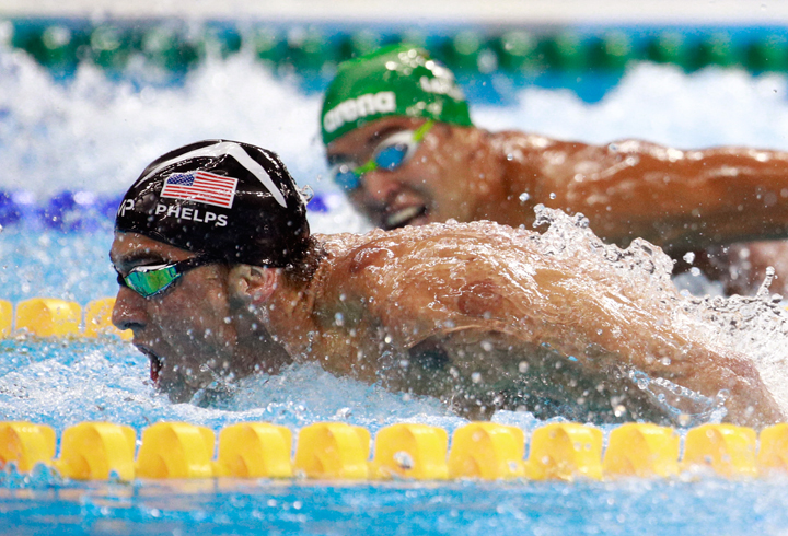 Michael Phelps (R) of the United States leads Chad le Clos of South Africa in the Men's 200m Butterfly Final on Day 4 of the Rio 2016 Olympic Games.