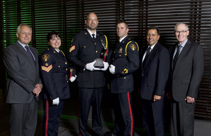 Three members of the Saskatoon Police Service were honoured Tuesday for their work on economic crime.